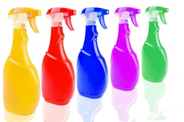 Cleaning products in multi-colored spray bottles
