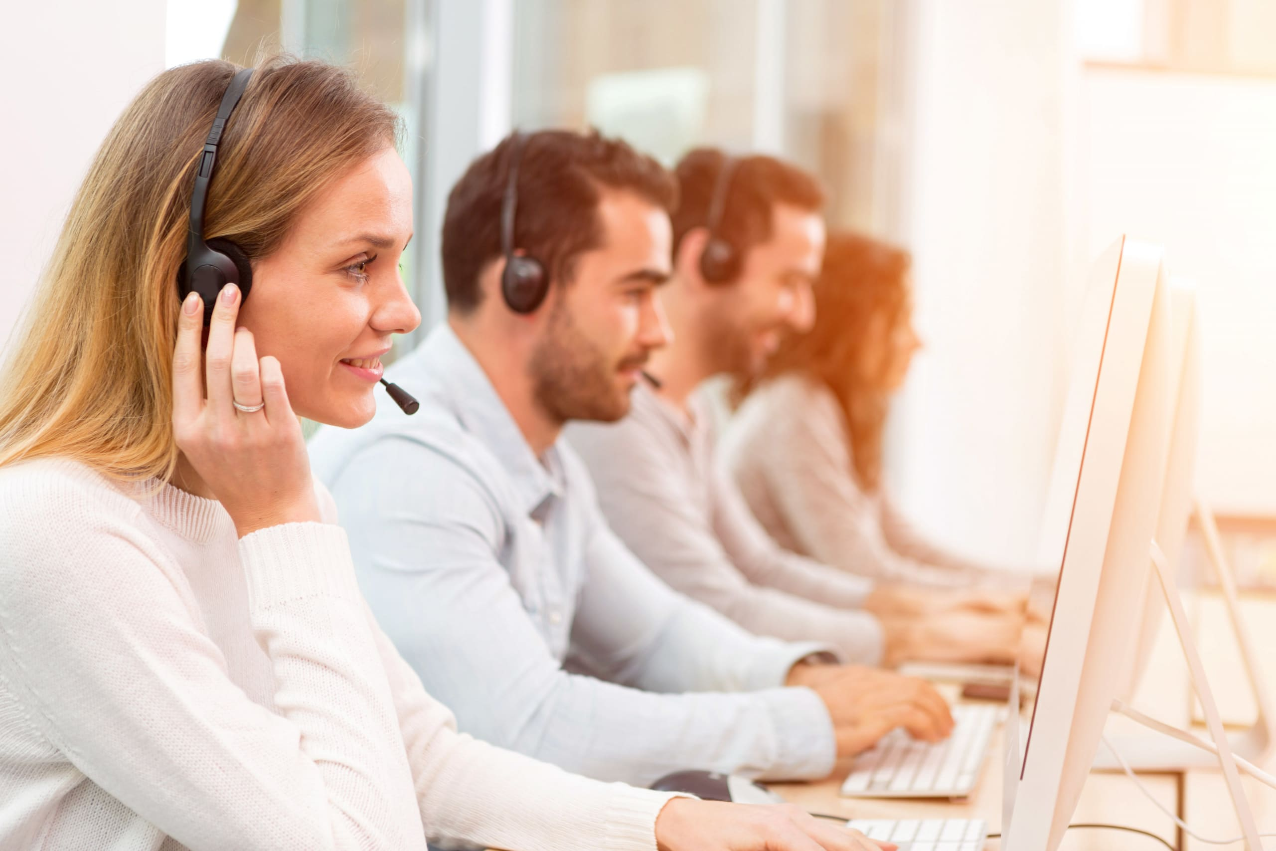 Image of a young attractive woman working in a call center.