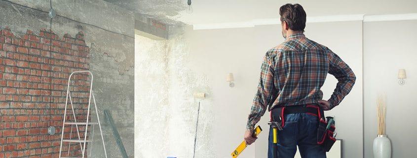 Handyman remodeling a room.