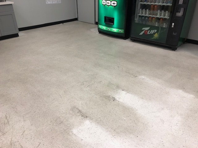 Before photo of a dirty, unwaxed floor.